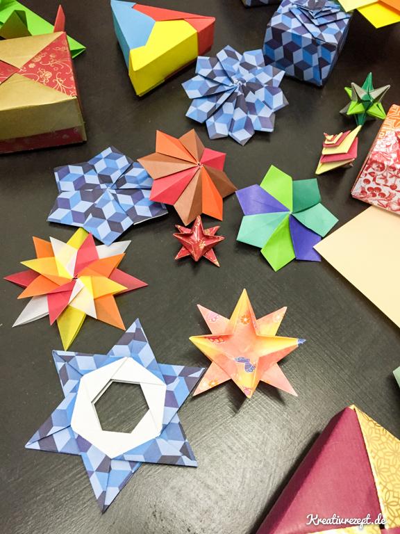fertige Origami-Schachteln und Sterne