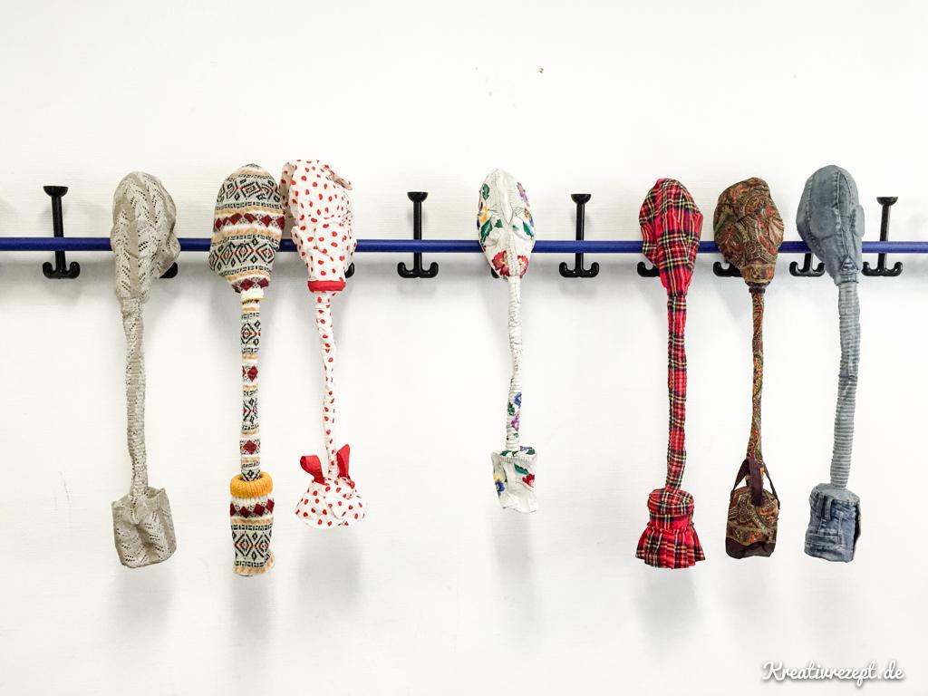 Gasmasken im Textilkleid